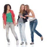 Young teens posing on white. Royalty Free Stock Images
