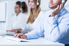 Young telemarketers in the office Stock Image