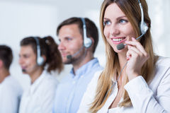Young telemarketers and products Royalty Free Stock Images