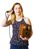 Young telephonist phoning using old vintage phone Royalty Free Stock Image