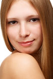 Young and tender. Young beautiful woman with long blond hair isolated on white background. Close-up Stock Photography