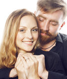 Young tender couple, man and woman in love  on white, fooling around real modern hipster marriage Royalty Free Stock Photography