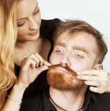 Young tender couple, man and woman in love  on white, fooling around real modern hipster marriage Stock Photography
