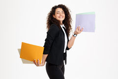Young tender curly girl holding documents Royalty Free Stock Images