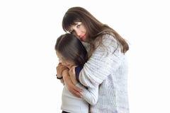 Young tender mom hugs her child in Studio Stock Image