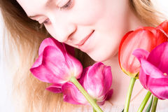 Young tender woman with flowers Royalty Free Stock Image