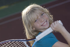 Young Tennis Player. Confident Elementary Age Girl on the Tennis Court Royalty Free Stock Image