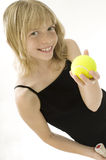 Young Tennis Player. Confident Elementary Age Girl with Tennis Ball Royalty Free Stock Images