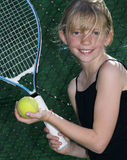 Young Tennis Player. Confident Elementary Age Girl with Tennis Ball and Racket Stock Image