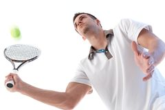 Young tennis player in action Royalty Free Stock Photography