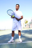 Young tennis player dressed in white Royalty Free Stock Photo