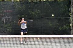 Young tennis player hitting Royalty Free Stock Images