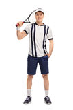 Young tennis player holding a racket. Full length portrait of a young tennis player holding a racket isolated on white background Royalty Free Stock Photo
