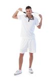 Young tennis player posing with tennis racket. Handsome young tennis player posing with tennis racket in hand, smiling Royalty Free Stock Image