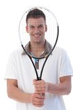 Young tennis player smiling happily Royalty Free Stock Photo