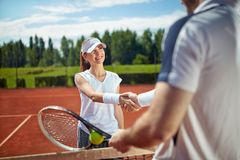 Young tennis player on tennis court Stock Image