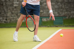 Young tennis player about to serve Stock Images