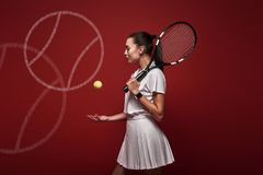 Talk with your raquet, play with your heart. Young tennis player standing isolated over red background with a racket and. Young tennis player in white polo shirt stock image