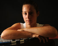 Young tennis pro - seated port Royalty Free Stock Image