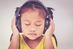Young Thai girl listen the music Royalty Free Stock Image