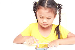 Young Thai girl using smartphone isolated on white Stock Photos