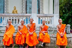Young Thai Monks. Sit outside their monastary or wat in Thailand Royalty Free Stock Photography
