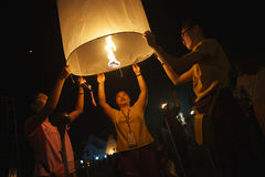 Young Thai People Launching Sky Lantern Royalty Free Stock Photos