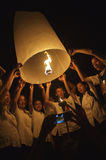 Young Thai People Launching Sky Lantern Royalty Free Stock Photo