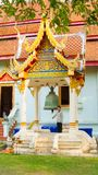 Young Thai plays ceremonial bell stock photography