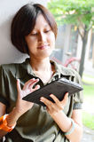 Young thai women with tablet-pc. Beatiful young thai woman enjoy with tablet-pc Royalty Free Stock Images