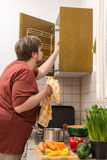 Young thick man is cooking a fresh and healthy dish Stock Photography