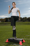 Young thin woman exercising outdoors Stock Photos