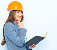 Young thinking business woman portrait. Woman builder studio portrait Stock Images