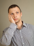 Young thinking Caucasian man Stock Image