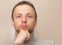 Young thinking Caucasian Man closeup portrait Royalty Free Stock Image