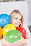 Young Thinking Woman With Colorful Balloons Stock Photography