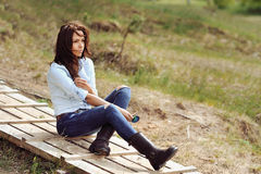 Young thinking woman outdoor portrait Royalty Free Stock Photo