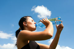 Young thirsty girl drinking water Royalty Free Stock Photography