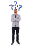 Young thoughtful african american man  surrounded by question ma Stock Photography