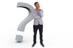 Young thoughtful african american man  surrounded by question ma Royalty Free Stock Image