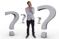 Young thoughtful african american man  surrounded by question ma Royalty Free Stock Photos