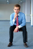 Young thoughtful businessman in blue shirt Stock Photography