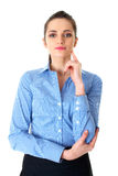 Young thoughtful female in blue shirt isolated Stock Photos
