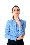 Young thoughtful female in blue shirt isolated Stock Photography