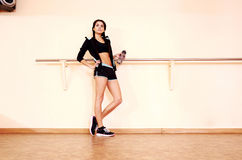 Young thoughtful fit woman standing. At gym Stock Image