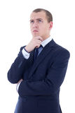 Young thoughtful handsome business man in blue suit isolated on Stock Photos