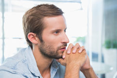 Young thoughtful man looking in the distance Stock Photo