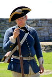 Young thoughtful man,reenacting a day in the life of a soldier,Fort Ticonderoga,New York,2015 Royalty Free Stock Photo