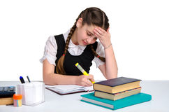 Young thoughtful schoolgirl in unform Stock Images
