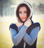 Young thoughtful woman in hood Stock Image